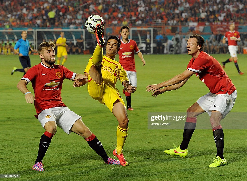 Philippe Coutinho of Liverpool competes with Jonny Evans and Luke Shaw of Manchester United during the International Champions Cup 2014 final match between Liverpool FC and Manchester United at Sun Life Stadium on August 4, 2014 in Miami Gardens, Florida.