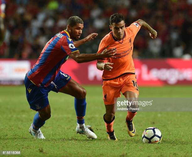 Philippe Coutinho of Liverpool competes with Ruben LoftusCheek of Crystal Palace during the Premier League Asia Trophy match between Liverpool FC and...