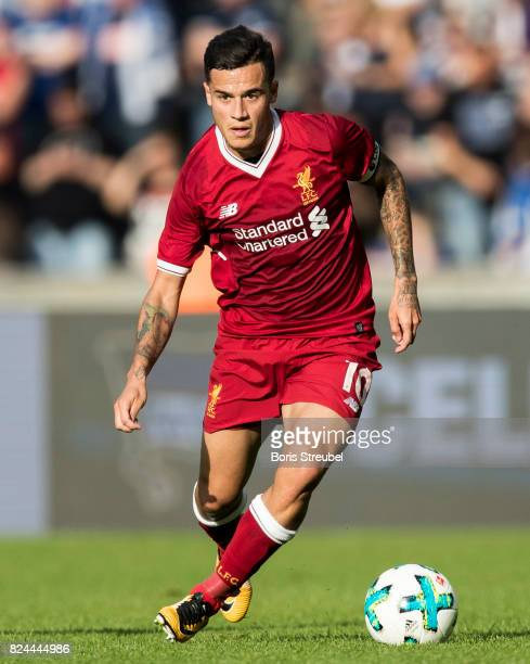 Philippe Coutinho of Liverpool FC runs with the ball during the Preseason Friendly match between Hertha BSC and FC Liverpool at Olympiastadion on...