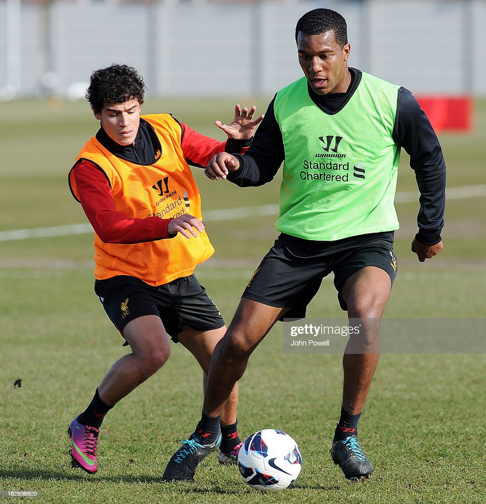 <a gi-track='captionPersonalityLinkClicked' href=/galleries/search?phrase=Philippe+Coutinho&family=editorial&specificpeople=6735575 ng-click='$event.stopPropagation()'>Philippe Coutinho</a> (L) of Liverpool FC with Andre Wisdom during a training session at Melwood Training Ground on February 28, 2013 in Liverpool, England.