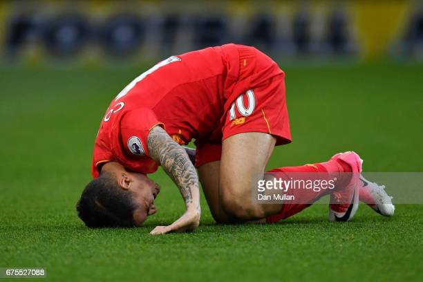 Philippe Coutinho of Liverpool goes down injured during the Premier League match between Watford and Liverpool at Vicarage Road on May 1 2017 in...