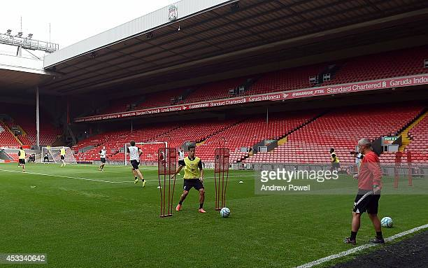 Philippe Coutinho of Liverpool in action during a training session at Anfield on August 8 2014 in Liverpool England