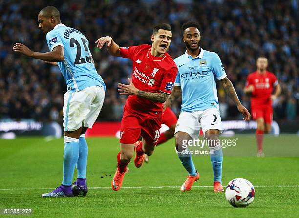 Philippe Coutinho of Liverpool is blocked by Fernandinho and Raheem Sterling of Manchester City during the Capital One Cup Final match between...