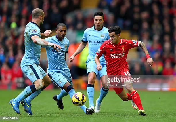Philippe Coutinho of Liverpool is closed down by Manchester City defence during the Barclays Premier League match between Liverpool and Manchester...