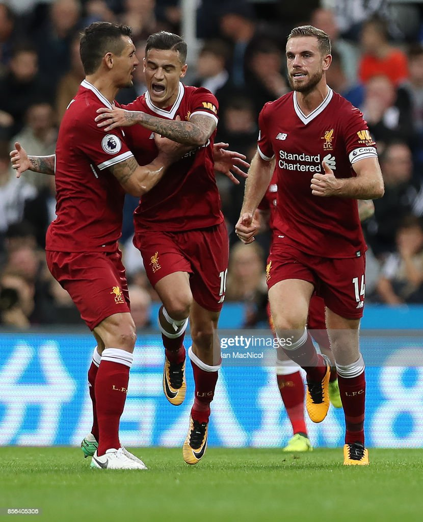 Philippe Coutinho of Liverpool is congratulated by team mates after opening the scoring during the Premier League match between Newcastle United and Liverpool at St. James Park on October 1, 2017 in Newcastle upon Tyne, England.