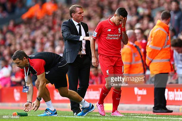 Philippe Coutinho of Liverpool is consoled by Brendan Rodgers manager of Liverpool after receiving a red card during the Barclays Premier League...