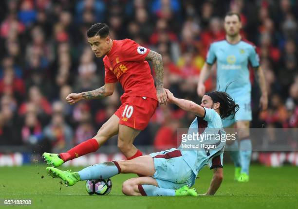 Philippe Coutinho of Liverpool is tackled by George Boyd of Burnley during the Premier League match between Liverpool and Burnley at Anfield on March...