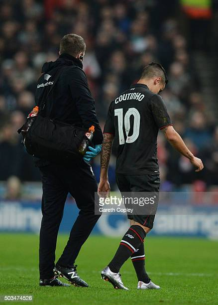 Philippe Coutinho of Liverpool leaves the pitch due to injury during the Capital One Cup semi final first leg match between Stoke City and Liverpool...