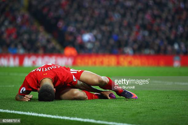 Philippe Coutinho of Liverpool lies injured during the Premier League match between Liverpool and Sunderland at Anfield on November 26 2016 in...