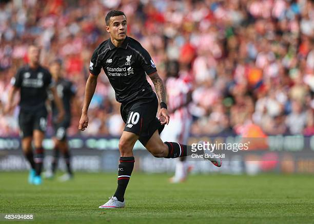 Philippe Coutinho of Liverpool looks on as he scores their first goal during the Barclays Premier League match between Stoke City and Liverpool at...