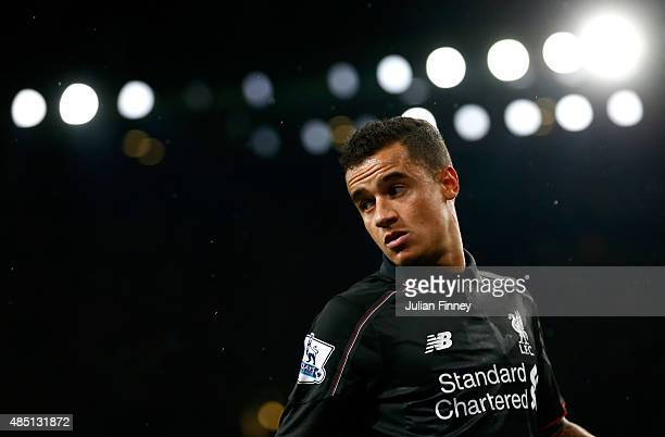 Philippe Coutinho of Liverpool looks on during the Barclays Premier League match between Arsenal and Liverpool at the Emirates Stadium on August 24...