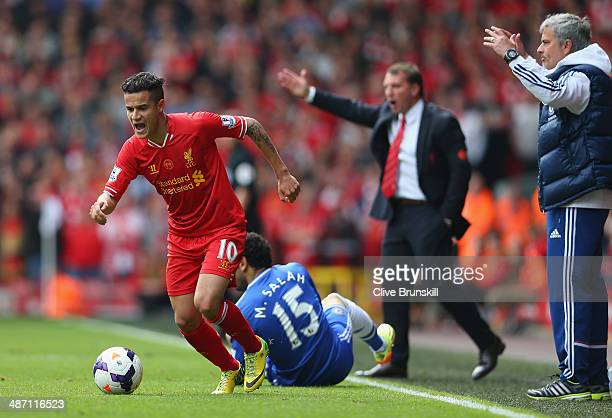 Philippe Coutinho of Liverpool moves away from Mohamed Salah of Chelsea during the Barclays Premier League match between Liverpool and Chelsea at...