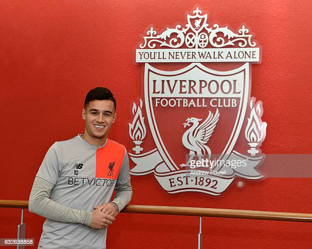 Philippe Coutinho of Liverpool poses after signing a new contract at Melwood Training Ground on January 24 2017 in Liverpool England
