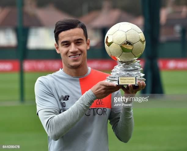 Philippe Coutinho of Liverpool poses with the Samba d'Or Trophy during a training session at Melwood Training Ground on February 22 2017 in Liverpool...
