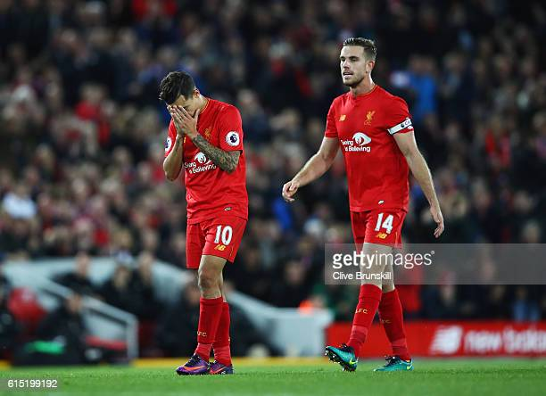 Philippe Coutinho of Liverpool reacts with Jordan Henderson during the Premier League match between Liverpool and Manchester United at Anfield on...