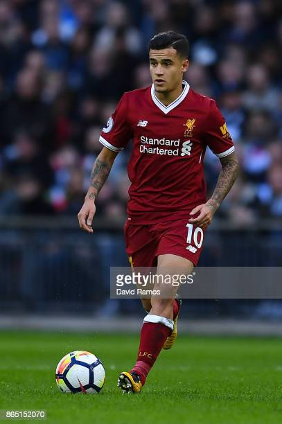 Philippe Coutinho of Liverpool runs with the ball during the Premier League match between Tottenham Hotspur and Liverpool at Wembley Stadium on...
