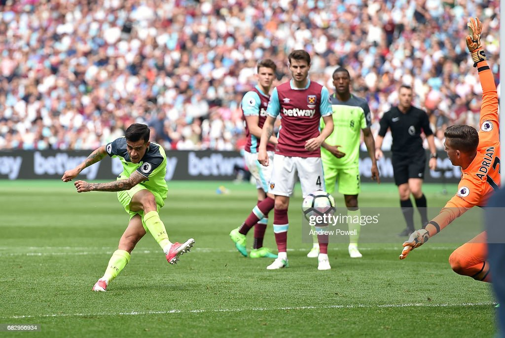 Philippe Coutinho of Liverpool scores his second and third for Liverpool during the Premier League match between West Ham United and Liverpool at London Stadium on May 14, 2017 in Stratford, England.