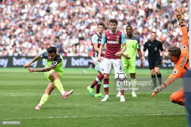 Philippe Coutinho of Liverpool scores his second and third for Liverpool during the Premier League match between West Ham United and Liverpool at...