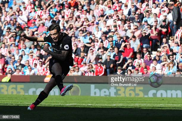 Philippe Coutinho of Liverpool scores his side's first goal during the Premier League match between Stoke City and Liverpool at Bet365 Stadium on...