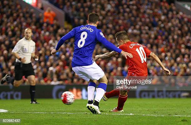 Philippe Coutinho of Liverpool scores his sides fourth goal during the Barclays Premier League match between Liverpool and Everton at Anfield April...