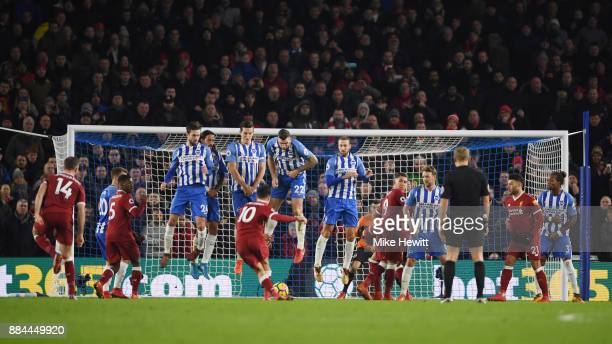 Philippe Coutinho of Liverpool scores his sides fourth goal during the Premier League match between Brighton and Hove Albion and Liverpool at Amex...