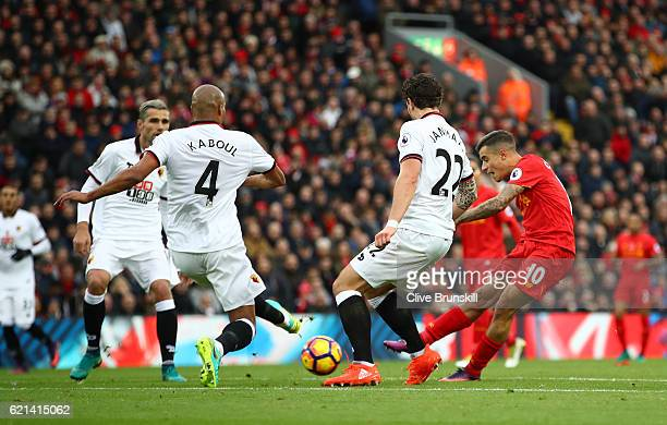 Philippe Coutinho of Liverpool scores his sides second goal during the Premier League match between Liverpool and Watford at Anfield on November 6...