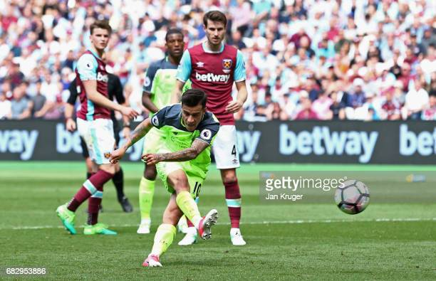 Philippe Coutinho of Liverpool scores his sides second goal during the Premier League match between West Ham United and Liverpool at London Stadium...