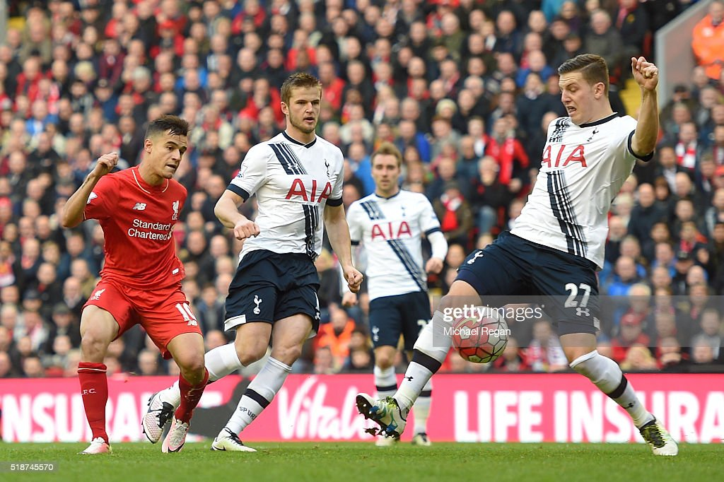 Philippe Coutinho of Liverpool scores his team's first goal during the Barclays Premier League match between Liverpool and Tottenham Hotspur at...