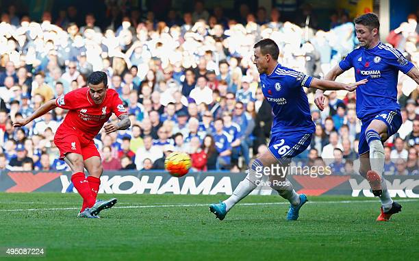 Philippe Coutinho of Liverpool scores his team's second goal during the Barclays Premier League match between Chelsea and Liverpool at Stamford...