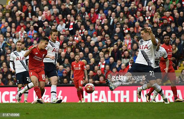 Philippe Coutinho of Liverpool scores the first goal during the Barclays Premier League match between Liverpool and Tottenham Hotspur at Anfield on...
