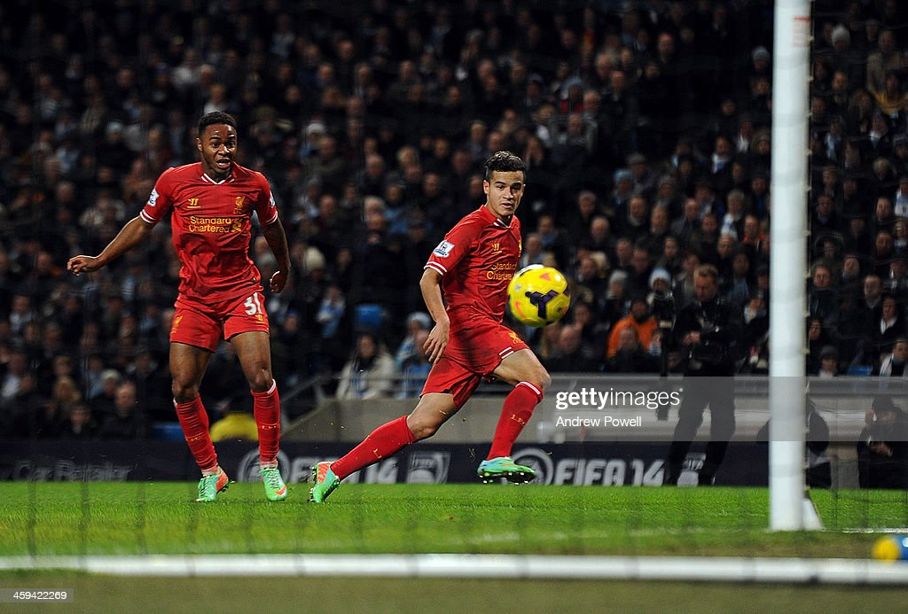 <a gi-track='captionPersonalityLinkClicked' href=/galleries/search?phrase=Philippe+Coutinho&family=editorial&specificpeople=6735575 ng-click='$event.stopPropagation()'>Philippe Coutinho</a> of Liverpool scores the opening goal during the Barclays Premier League match between Manchester United and Liverpool at Etihad Stadium on December 26, 2013 in Manchester, England.
