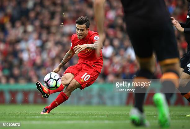 Philippe Coutinho of Liverpool scores their fourth goal during the Premier League match between Liverpool and Hull City at Anfield on September 24...
