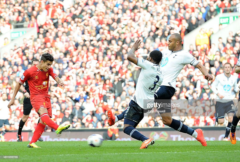 Philippe Coutinho of Liverpool scores to make it 3-0 during the Barclays Premier League match between Liverpool and Tottenham Hotspur at Anfield on March 30, 2014 in Liverpool, England.