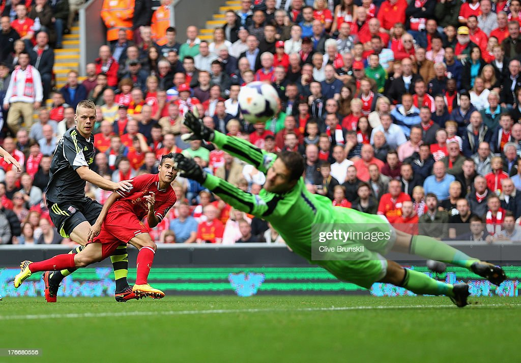 <a gi-track='captionPersonalityLinkClicked' href=/galleries/search?phrase=Philippe+Coutinho&family=editorial&specificpeople=6735575 ng-click='$event.stopPropagation()'>Philippe Coutinho</a> of Liverpool shoots past <a gi-track='captionPersonalityLinkClicked' href=/galleries/search?phrase=Asmir+Begovic&family=editorial&specificpeople=4184467 ng-click='$event.stopPropagation()'>Asmir Begovic</a> of Stoke City during the Barclays Premier League match between Liverpool and Stoke City at Anfield on August 17, 2013 in Liverpool, England.