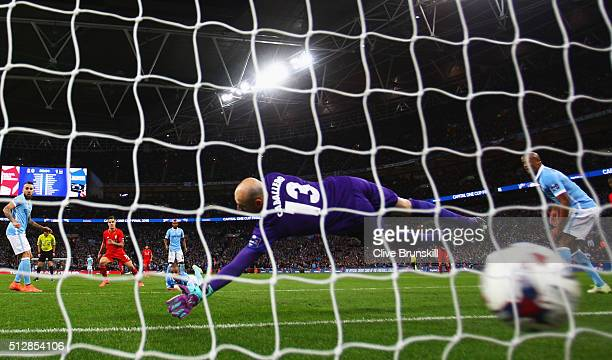Philippe Coutinho of Liverpool shoots past goalkeeper Willy Caballero of Manchester City to score their first and equalising goal during the Capital...