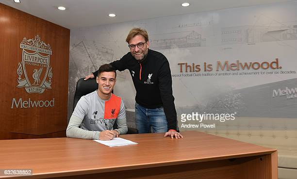 Philippe Coutinho of Liverpool signs a new contract with Jurgen Klopp manager of Liverpool at Melwood Training Ground on January 24 2017 in Liverpool...