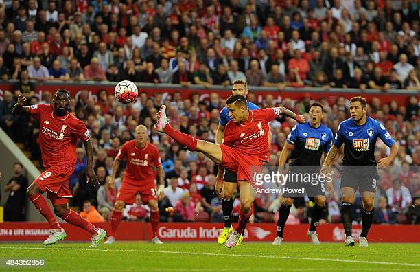 Philippe Coutinho of Liverpool stretches a leg to the ball during the Barclays Premier League match between Liverpool and AFC Bournemouth on August...