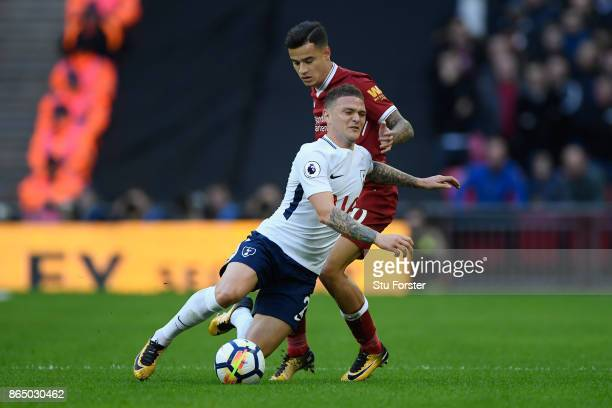 Philippe Coutinho of Liverpool tackles Kieran Trippier of Tottenham Hotspur during the Premier League match between Tottenham Hotspur and Liverpool...