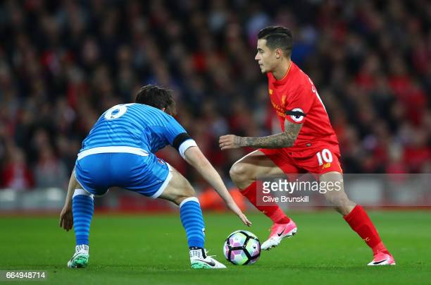 Philippe Coutinho of Liverpool takes on Harry Arter of AFC Bournemouth during the Premier League match between Liverpool and AFC Bournemouth at...