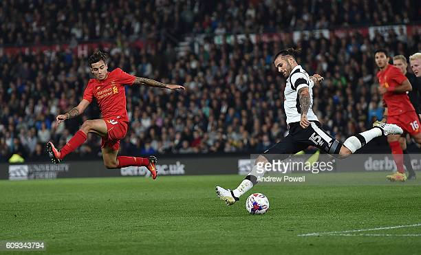 Philippe Coutinho of Liverpool tries to block Bradley Johnson of Derby County during the EFL Cup third round match between Derby County and Liverpool...