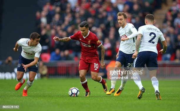 Philippe Coutinho of Liverpool tries to break through during the Premier League match between Tottenham Hotspur and Liverpool at Wembley Stadium on...