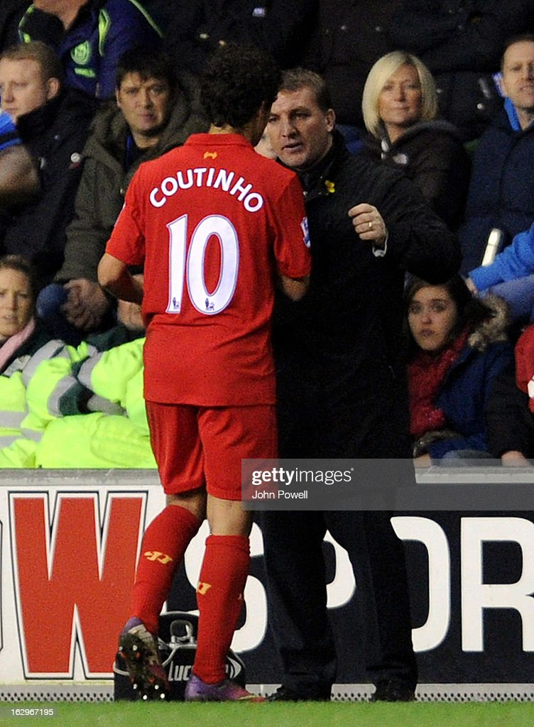 Philippe Coutinho of Liverpool with Brendan Rodgers manager of Liverpool as he comes off during the Barclays Premier League match between Wigan Athletic and Liverpool at DW Stadium on March 2, 2013 in Wigan, England.