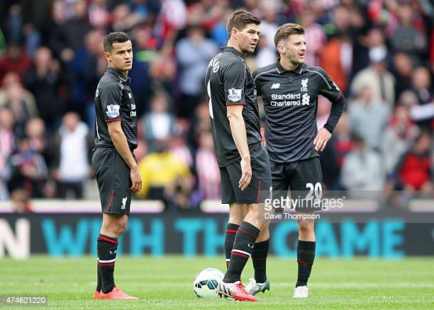Philippe Coutinho Steven Gerrard and Adam Lallana of Liverpool react during the Barclays Premier League match between Stoke City and Liverpool at...