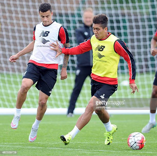 Philippe Coutinho with Roberto Firmino of Liverpool during a Liverpool FC training session at Melwood Training Ground on July 30 2015 in Liverpool...