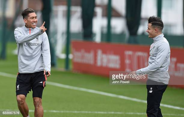 Philippe Coutinho with Roberto Firmino of Liverpool during a training session at Melwood Training Ground on February 2 2017 in Liverpool England