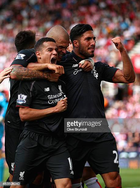 Philippe Coutino of Liverpool celebrates after scoring the winning goal with team mates Emre Can and Martin Skrtel during the Barclays Premier League...