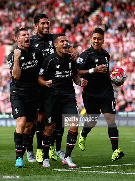 Philippe Coutino of Liverpool celebrates after scoring the winning goal with team mates Emre CanRoberto Firmino and James Milner during the Barclays...