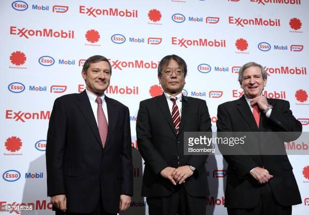 Philippe Ducom president of ExxonMobil Group Japan left Jun Muto managing director of TonenGeneral Sekiyu KK center and Sherman Glass vice president...
