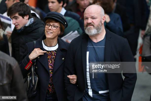 Philippe Etchebest and his wife Dominique Etchebest attend the Grand Prix Hermes CSI5 show jumping event on day three of the Saut Hermes at the Grand...