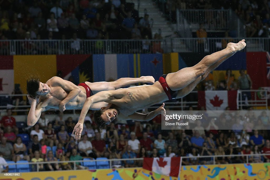 TORONTO, ON- JULY 13 - Philippe Gagne and Maxim Imbeau-Dulac twist during their last dive, the pair would win the silver medal in the men's 3 metre synchronized springboard diving final at the Pan Am Games at CIBC Aquatic Centre/Field House in Toronto. July 13, 2015.
